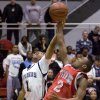 James Davis of Midwest City and Joseph Rogers of Carl Albert fight for a rebound during a high school basketball game at Carl Albert in Midwest City, Okla., Friday, Jan. 25, 2008. BY BRYAN TERRY, THE OKLAHOMAN