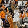 Oklahoma State\'s Michael Cobbins (20) grabs a rebound over Texas\' Jonathan Holmes (10) during an NCAA college basketball game between Oklahoma State University (OSU) and the University of Texas (UT) at Gallagher-Iba Arena in Stillwater, Okla., Saturday, Feb. 18, 2012. Oklahoma State won 90-78. Photo by Bryan Terry, The Oklahoman