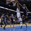 Oklahoma City\'s Serge Ibaka (9) goes up for a basket as Charlotte\'s Anthony Tolliver (43) fouls him during the NBA basketball game between the Oklahoma City Thunder and the Charlotte Bobcats at the Chesapeake Energy Arena, Sunday, March 2, 2014. Photo by Sarah Phipps, The Oklahoman