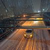 Photo - Taxis drive across the Brooklyn Bridge during a winter storm in New York, late Thursday, Jan. 2, 2014. The storm is expected to bring snow, stiff winds and punishing cold into the Northeast. (AP Photo/Karly Domb Sadof)