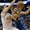 Photo - Minnesota Timberwolves Ricky Rubio (9) drives past Phoneix Suns guard Goran Dragic, of Slovenia, during the first half of an NBA basketball game, Tuesday, Feb. 25, 2014, in Phoenix. (AP Photo/Matt York)