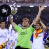 Photo - Real goalkeeper Iker Casillas lifts the trophy at the end of the final of the Copa del Rey between FC Barcelona and Real Madrid at the Mestalla stadium in Valencia, Spain, Wednesday, April 16, 2014. Real defeated Barcelona 2-1. (AP Photo/Manu Fernandez)