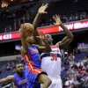 Detroit Pistons guard Brandon Knight (7) drives to the basket against Washington Wizards center Emeka Okafor (50) during the first half of an NBA basketball game, Saturday, Dec. 22, 2012, in Washington. (AP Photo/Nick Wass)