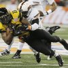 Missouri wide receiver Dorial Green-Beckham (15) is tackled by Oklahoma State safety Daytawion Lowe (8) during the second half of the Cotton Bowl NCAA college football game on Friday, Jan. 3, 2014, in Arlington, Texas. (AP Photo/Brandon Wade)