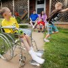 Anthony Middleton, 11, left, makes bubbles as his brother Jackie Middleton, 9, right, chases the bubbles while parents Michael Snider and Jennifer Snider sit on the porch with DeJay Middleton, 6. at their home in Cordell, Okla., Thursday, May 6, 2010. Anthony, Jackie and DeJay have ALD (adrenoleukodystrophy). Photo by Nate Billings, The Oklahoman
