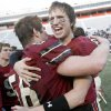 Lincoln Christian\'s Cale Grauer, right, celebrates with Cameron Johnson after winning the Class 2A high school football state championship game between Kingfisher and Lincoln Christian at Boone Pickens Stadium in Stillwater, Okla., Saturday, December 12, 2009. Photo by Bryan Terry, The Oklahoman
