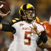 Photo - Maryland quarterback Danny O'Brien throws to a receiver in the first half of an NCAA football game against Miami in College Park, Md., Monday, Sept. 5, 2011. (AP Photo/Patrick Semansky) ORG XMIT: MDPS106