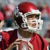 Photo - Quarterback Sam Bradford warms up before the college football game between The University of Oklahoma Sooners (OU) and the Baylor Bears at the Gaylord Family -- Oklahoma Memorial Stadium on Saturday, Oct. 10, 2009, in Norman, Okla.   Photo by Steve Sisney, The Oklahoman. ORG XMIT: KOD