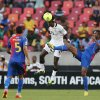 Ghana\'s John Boye, center, heads the ball as he defends against Cape Verde\'s Fernando Varela, right, and teammate Babanco