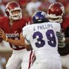Oklahoma\'s Sam Bradford (14) stands in the pocket behind the protection of Phil Loadholt (79) who blocks TCU\'s Jason Phillips (39) during the first half of the college football game between the University of Oklahoma Sooners (OU) and Texas Christian University Horned Frogs (TCU) at the Gaylord Family -- Oklahoma Memorial Stadium on Saturday, Sept 27, 2008, in Norman, Okla. by Chris Landsberger, The Oklahoman ORG XMIT: KOD