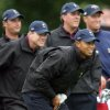 United States Ryder Cup team players, Phil Mickelson, rear 2nd right, Scott Verplank, 2nd left, and Chris DiMarco, left, look on as Tiger Woods watches the flight of his shot on the 6th hole during a practice round at the K Club golf course, Straffan, Ireland, Wednesday Sept. 20, 2006. The Ryder Cup, is scheduled to get underway on Friday Sept. 22.(AP Photo/Peter Morrison) ** EDITORIAL USE ONLY ** ORG XMIT: KC154