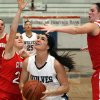Claremore\'s Miranda Taylor , right, and teammates defend a shot attempt by Shawnee\'s Taylor Cooper during a girls\' Class 5A state basketball tournament game Thursday, March 8, 2012, in Sapulpa, Okla. (AP Photo/Tulsa World, Cory Young) ORG XMIT: OKTUL402