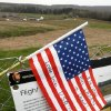 An American is flag placed at the temporary memorial to United Flight 93 in Shanksville, Pa., with the crash site and permanent memorial construction in the rear on Monday, May 2, 2011. Osama bin Laden, the face of global terrorism and architect of the Sept. 11, 2001, attacks, was killed in a firefight with elite American forces in Pakistan on Monday, May 2, 2011 then quickly buried at sea. (AP Photo/Gene J. Puskar) ORG XMIT: PAGP102