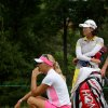 Photo - Anna Nordqvist, of Sweden, sits on the tee box next to So Yeon Ryu, of South Korea, during a delay in action on the third hole during second round play at the Canadian Pacific Women's Open golf tournament in London, Ontario, Friday, Aug. 22, 2014. (AP Photo/The Canadian Press, Dave Chidley)