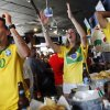 Photo -  Brazilian fans Ricardo Lima, Melissa Gomes and Peterson Neri — all from Brazil — react to a missed chance Tuesday during a World Cup watch party for the Brazil versus Mexico game at Medio Tiempo Sports Cantina and Grill. Photo by K.T. King, The Oklahoman   KT King -