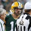 Green Bay Packers quarterback Aaron Rodgers talks with an official after getting poked in the eye during the second half of an NFL football game against the New Orleans Saints on Sunday, Sept. 30, 2012 in Green Bay, Wis. The Packers won 28-27. (AP Photo/Mike Roemer)