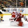 Photo - Boston Bruins' Milan Lucic, left, scores on Detroit Red Wings goalie Jimmy Howard during the second period of Game 2 of a first-round NHL hockey playoff series in Boston Sunday, April 20, 2014. (AP Photo/Winslow Townson)