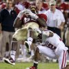 Oklahoma\'s Jamell Fleming (32) brings down Florida\'s Beau Reliford (88) during a college football game between the University of Oklahoma (OU) and Florida State (FSU) at Doak Campbell Stadium in Tallahassee, Fla., Saturday, Sept. 17, 2011. Oklahoma won 23-13. Photo by Bryan Terry, The Oklahoman