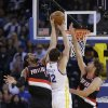 Photo - Portland Trail Blazers' LaMarcus Aldridge, left, blocks a shot attempt from Golden State Warriors' Andrew Bogut (12) during the first half of an NBA preseason basketball game on Thursday, Oct. 24, 2013, in Oakland, Calif. (AP Photo/Marcio Jose Sanchez)