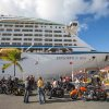 Photo - Passengers from a motorcycle cruises' tour group, prepare to board the Royal Caribbean International's Explorer of the Seas, docked at Charlotte Amalie Harbor in St. Thomas, U. S. Virgin Islands, Sunday, Jan. 26, 2014. Health officials have boarded the cruise liner to investigate an illness outbreak that has stricken at least 300 people with gastrointestinal symptoms including vomiting and diarrhea. Over 13 of the 34 motorcycle riders fell ill during the trip. (AP Photo/Thomas Layer)