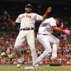 Photo - Boston Red Sox first baseman David Ortiz, left, bends out of the way after receiving the throw to force out St. Louis Cardinals' Oscar Taveras in the fourth inning of a baseball game Tuesday, Aug. 5, 2014, in St. Louis. (AP Photo/St. Louis Post-Dispatch, Chris Lee)