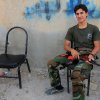 A Syrian rebel sits with his weapon on his knee in the rebel-held town of Tel Abyad, Syria , Friday, Oct. 5, 2012 which lies close to the Turkish Syrian border. Turkey\'s state-run news agency says Turkish troops have returned fire after a mortar shell from Syria again landed on its territory. Turkish artillery has fired at Syrian targets for two straight days after shelling from Syria killed five civilians in Turkey. Turkey\'s parliament on Thursday also voted to allow cross border military operations in Syria. (AP Photo)