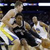 Golden State Warriors\' David Lee, left, defends against Brooklyn Nets\' MarShon Brooks (9) during the first half of an NBA basketball game in Oakland, Calif., Wednesday, Nov. 21, 2012. (AP Photo/Marcio Jose Sanchez)
