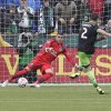Photo - Seattle Sounders midfielder Clint Dempsey, right, scores on a penalty kick to tie the game against Portland Timbers goalkeeper Andrew Weber late in the second half of an MLS soccer game in Portland, Ore., Saturday, April 5, 2014. The two teams tied 4-4. (AP Photo/Don Ryan)