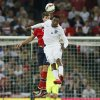 Photo - England's Daniel Sturridge, front, jumps for the ball with Norway's Harvard Nordtveit during the international friendly soccer match between England and Norway at Wembley Stadium in London, Wednesday, Sept. 3, 2014. (AP Photo/Alastair Grant)