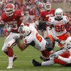 BEDLAM: Oklahoma\'s Allen Patrick (23) gets past Oklahoma State\'s Ricky Price (6) during the first half of the college football game between the University of Oklahoma Sooners (OU) and the Oklahoma State University Cowboys (OSU) at the Gaylord Family -- Oklahoma Memorial Stadium on Saturday, Nov. 24, 2007, in Norman, Okla. Photo By CHRIS LANDSBERGER, The Oklahoman ORG XMIT: KOD