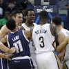 Photo - Oklahoma City Thunder forward Nick Collison, left, and New Orleans Pelicans guard Austin Rivers, third right, get into a scuffle in the first half of an NBA basketball game in New Orleans, Monday, April 14, 2014. Both were ejected from the game. (AP Photo/Gerald Herbert)