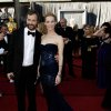 Judd Apatow, left, and Leslie Mann arrive before the 84th Academy Awards on Sunday, Feb. 26, 2012, in the Hollywood section of Los Angeles. (AP Photo/Matt Sayles) ORG XMIT: OSC166
