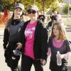 Shannon Lanthripe, a 4 year survivor from Moore, walks with her daughters Elania, 11, and Eva, 7, near the finish line during the 20th annual Susan G. Komen Race for the Cure in downtown Oklahoma City Sunday, October 20, 2013. Photo by Doug Hoke, The Oklahoman