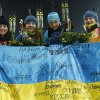 Photo - FILE - In this Friday, Feb. 21, 2014, file photo Ukraine's relay team Vita Semerenko, Juliya Dzhyma, Olena Pidhrushna and Valj Semerenko, from left, celebrate with a Ukrainian flag with writings on it after winning the gold during the women's biathlon 4x6k relay, at the 2014 Winter Olympics in Krasnaya Polyana, Russia. The Ukrainian city of Lviv withdrew its bid for the 2022 Winter Olympics on Monday June 30, 2014, becoming the third contender to drop out of the race for a games that no one seems to want. (AP Photo/Dmitry Lovetsky, File)