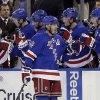 Photo - New York Rangers' Brad Richards (19) celebrates with teammates after scoring a goal during the first period of an NHL hockey game against the Carolina Hurricanes on Tuesday, April 8, 2014, in New York. (AP Photo/Frank Franklin II)