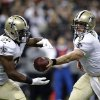 Photo - New Orleans Saints quarterback Drew Brees (9) hands off to running back Mark Ingram (22)in the first half of an NFL football game against the Atlanta Falcons in New Orleans, Sunday, Sept. 8, 2013. (AP Photo/Gerald Herbert)