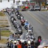 The parade of motorcycles approaches Pennsylvania Avenue on SW 29 Street. About 300 motorcycle riders participated in a charity ride in southwest Oklahoma City on Sunday afternoon, Dec. 9, 2012. Escorted by Oklahoma City police motorcycle units, the bikers traveled along SW 29 Street, S. Western, SW 44 Street and returned to Woodson Park at SW 36 and S. May Avenue. Feed The Children and the Fellowship of Christian Bikers sponsored the motorcycle ride/toy drive. Photo by Jim Beckel, The Oklahoman