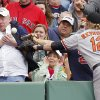 Photo -   Baltimore Orioles' Mark Reynolds (12) can not catch a foul ball in in the stands during the fifth inning of a baseball game against the Boston Red Sox in Boston, Saturday, May 5, 2012. (AP Photo/Michael Dwyer)