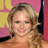 FILE - In this June 6, 2012 file photo, Miranda Lambert arrives at the 2012 CMT Music Awards in Nashville, Tenn. Brad Paisley and Carrie Underwood co-host the CMA awards show on Thursday, Nov. 1, 2012, at 8 p.m. EDT, live on ABC from the Bridgestone Arena in Nashville. When country music\'s biggest stars take the stage tonight, you\'ll see many of your favorites from the last 10 years, though increasingly, new faces are dominating the genre as country\'s fan base shifts to a younger-skewing audience. (Photo by John Shearer/Invision/AP, File)