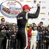 Photo - Will Power celebrates after winning the Milwaukee Mile IndyCar auto race Sunday, Aug. 17, 2014, in West Allis, Wis. (AP Photo/Morry Gash)