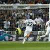 Photo - Real's Karim Benzema, right, scores the opening goal past Bayern goalkeeper Manuel Neuer during a first leg semifinal Champions League soccer match between Real Madrid and Bayern Munich at the Santiago Bernabeu stadium in Madrid, Spain, Wednesday, April 23, 2014. (AP Photo/Andres Kudacki)