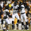 Vanderbilt safety Kenny Ladler (1) celebrates with defensive backs Steven Clarke (12) and Andre Hal (23) after intercepting a pass against Tennessee in the first quarter of an NCAA college football game on Saturday, Nov. 23, 2013, in Knoxville, Tenn. (AP Photo/Mark Zaleski)
