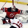 New Jersey Devils goalie Johan Hedberg (1), of Sweden, is unable to stop a shot by Devils center Travis Zajac (19) during an NHL hockey scrimmage against the Albany Devils, the team\'s AHL affiliate, Wednesday, Jan. 16, 2013, in Newark, N.J. (AP Photo/Julio Cortez)