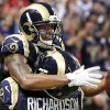 St. Louis Rams wide receiver Chris Givens, top, is congratulated by Barry Richardson after catching a 51-yard pass for a touchdown during the fourth quarter of an NFL football game against the Arizona Cardinals, Thursday, Oct. 4, 2012, in St. Louis. (AP Photo/Seth Perlman)