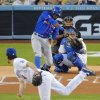 Photo - New York Mets' Curtis Granderson hits a solo home run off Los Angeles Dodgers starting pitcher Dan Haren, in front of catcher A.J. Ellis and home plate umpire Adam Hamari during the first inning of a baseball game, Friday, Aug. 22, 2014, in Los Angeles. (AP Photo/Mark J. Terrill)