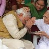 Photo - 90-year-old Hiraben blesses her son and India's next prime minister Narendra Modi at her home in Gandhinagar, in the western Indian state of Gujarat, Friday, May 16, 2014. Modi and his party won national elections in a landslide Friday, preliminary results showed, driving the long-dominant Congress party out of power in the most commanding victory India has seen in more than a quarter century. The Hindu nationalist Bharatiya Janata Party captured a commanding lead for at least 272 seats in the lower house of Parliament, the majority needed to create a government without forming a coalition with smaller parties. (AP Photo/Ajit Solanki)