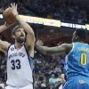 Memphis Grizzlies\' Marc Gasol (33), of Spain, shoots over New Orleans Hornets\' Al-Farouq Aminu (0) during the first half of an NBA basketball game in Memphis, Tenn., Sunday, Jan. 27, 2013. (AP Photo/Danny Johnston)
