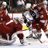 Phoenix Coyotes goalie Jason LaBarbera (1) makes a save on a shot by Columbus Blue Jackets\' Artem Anisimov (42), of Russia, as Coyotes\' Derek Morris (53) defends during the second period in an NHL hockey game, Wednesday, Jan. 23, 2013, in Glendale, Ariz. (AP Photo/Ross D. Franklin)