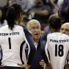 Penn State coach Russ Rose, center, talks to team members Ariel Scott (1) and Deja McClendon (18) during a time out in the national semifinals of the NCAA college women\'s volleyball tournament semifinal against Oregon in Louisville, Ky., Thursday, Dec. 13, 2012. (AP Photo/Garry Jones)