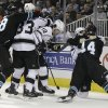 A fight breaks out between the San Jose Sharks and the Los Angeles Kings after a goal from the Kings\' Mike Richards (10) during the second period of an NHL hockey game Saturday, April 7, 2012 in San Jose, Calif. (AP Photo/Marcio Jose Sanchez)
